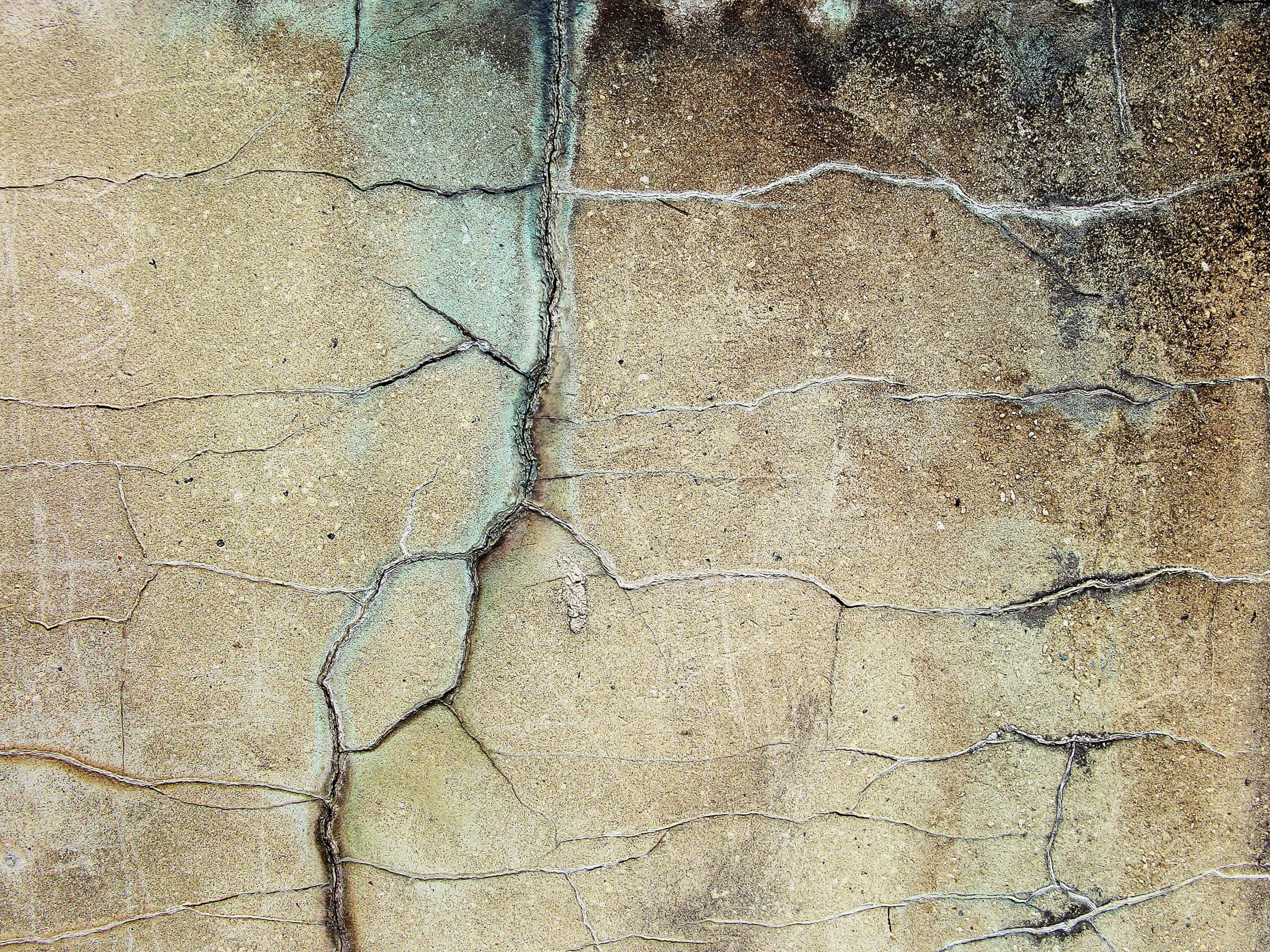 cracked brown concrete surface